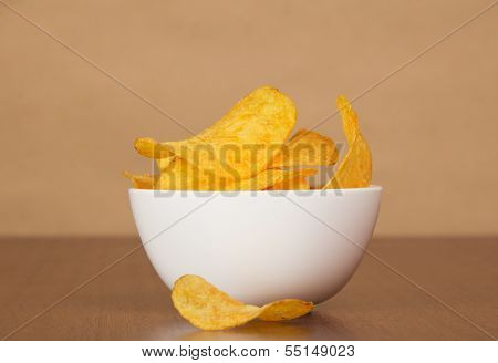 Faience bowl with chips against paper
