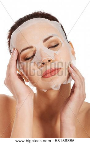 Beautiful woman with collagen mask. Isolated on white.