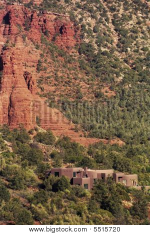 Arizona Red Rock Canyon With Buildings Nestled In Trees