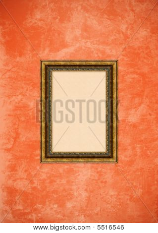 Grunge Orange Or Pink Stucco Wall With Empty Picture Frame