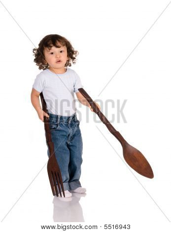 Child With Big Spoon And Fork