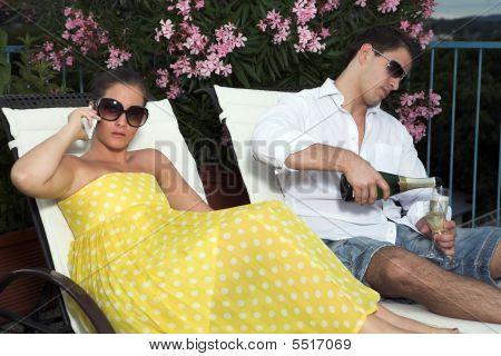 Stylish Couple Having A Drink On Terrace