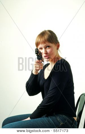 Girl On Chair With A Gun