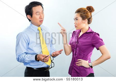 Angry argument among colleagues in an Asian business office