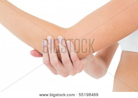 Close-up mid section of a young woman with elbow pain over white background