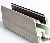 Fiberglass window profile sample covered by thin wood layer poster