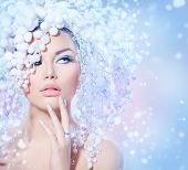 Winter Beauty Woman. Beautiful Fashion Model Girl with Snow Hair style and Make up. Holiday Makeup and Manicure. Winter Queen with Snow and Ice Hairstyle poster