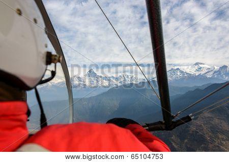 Pilot flying an ultralight in Nepal