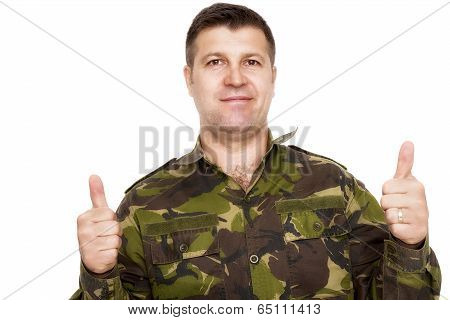 Oldier In Camouflage Uniform Showing Ok Sign