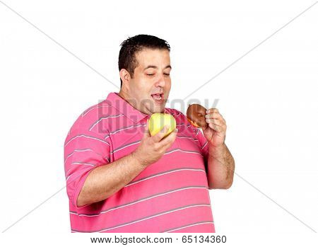 Fat man deciding between an apple and a sweet isolated on a white background