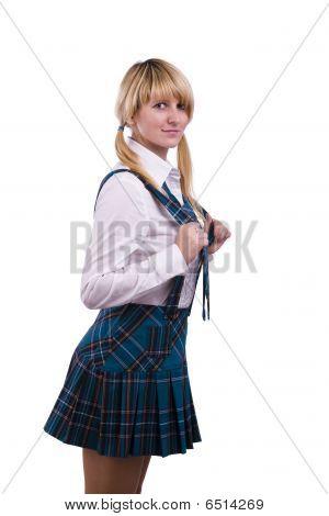 Senior High School Girl In Uniform Is Posing