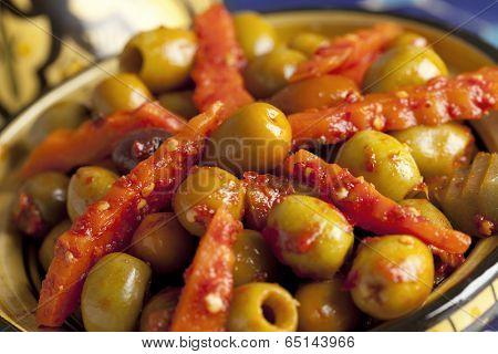 Moroccan hot harissa olives close up