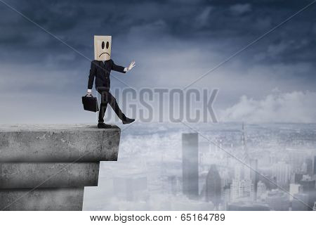 Businessman With Cardboard Head On Rooftop 1