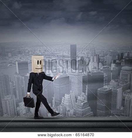 Businessman With Cardboard Head On Rooftop