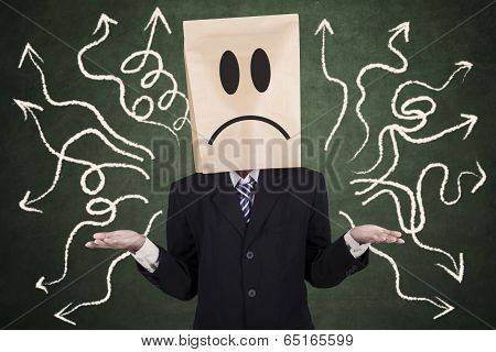 Confused Businessman With Paper Head
