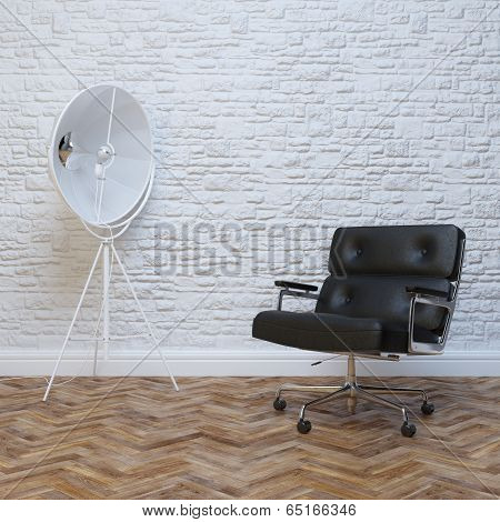 White Brick Wall Interior With Black Leather Office Armchair