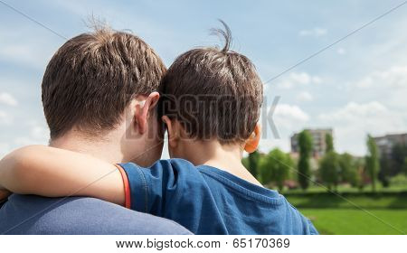 Father And Son On A City Background
