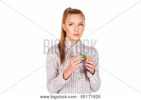 young woman concentrated solving the Rubik's Cube