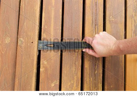 Removing Old Wooden Boards With Pry Bar