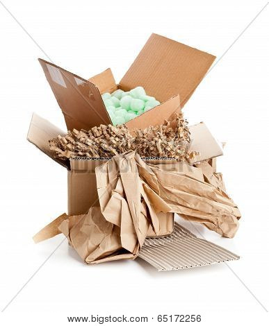 Heap of recyclable packaging materials - cardboard paper cornstarch pellets poster