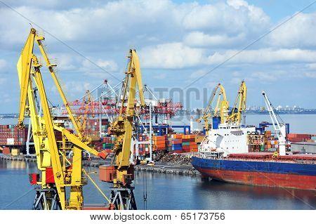 Bulk cargo ship under port crane bridge Odessa Ukraine poster