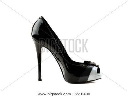 Photo Of Elegant Modern Female's Black Shoe Over White