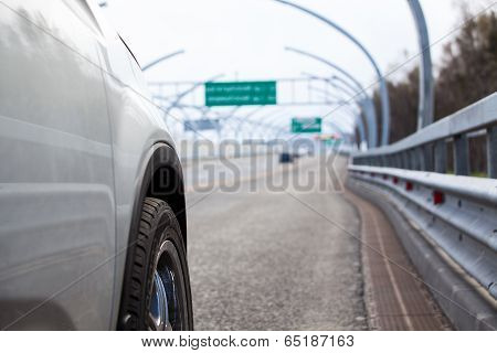 Car Standing On Wayside With Side Road View