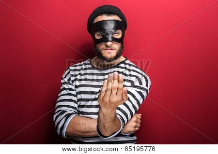 Angry criminal inviting with hand