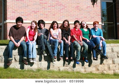 Group Of Kids Sitting On Wall
