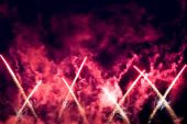 Blue red yellow firework in a night sky poster