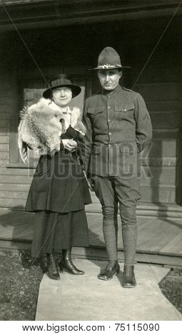 CANADA - CIRCA 1930s: Vintage photo shows Portrait of an officer and his wife.