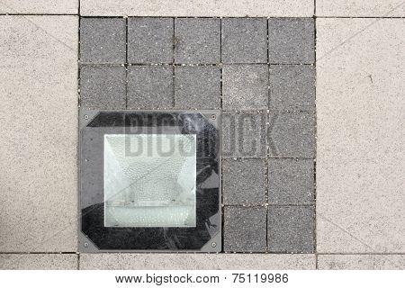light source on stone pavement urban detail poster