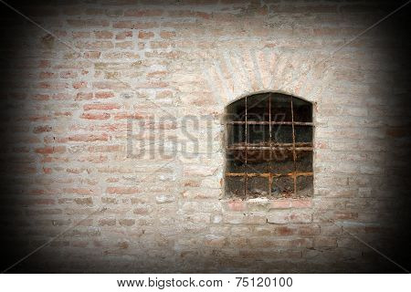detail of a medieval window on fortress exterior brick wall poster