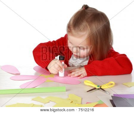 Girl Playing With Paper And Glue