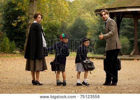 Family Of Four In Park Beside Bandstand