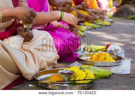 Hindu women making a ritual offering.
