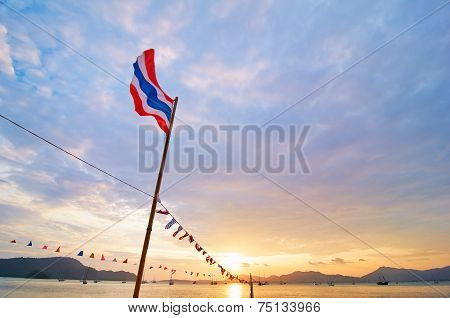 Flag of Thailand on the beautiful sunset background.