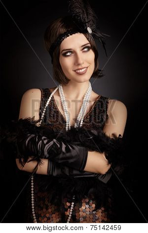 Beautiful retro woman from the roaring 20s ready to party
