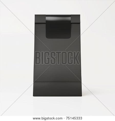 Black Paper Bag With Black Sticker On Light Background