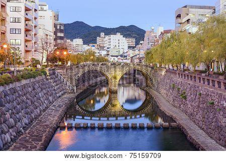 Nagasaki, Japan cityscape at Megane Spectacles Bridge. poster