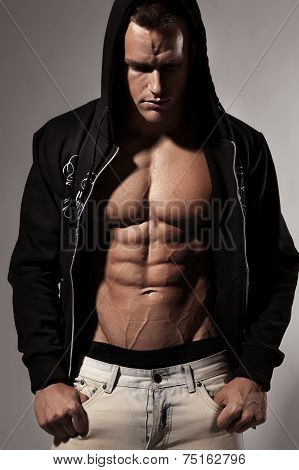 Strong Athletic Man Fitness Model Torso showing six pack abs. isolated on neutral background poster