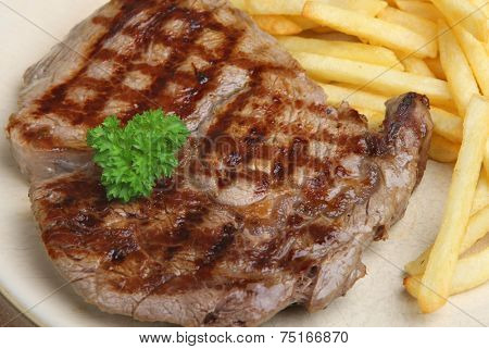 Rib-eye beef steak served with fries.