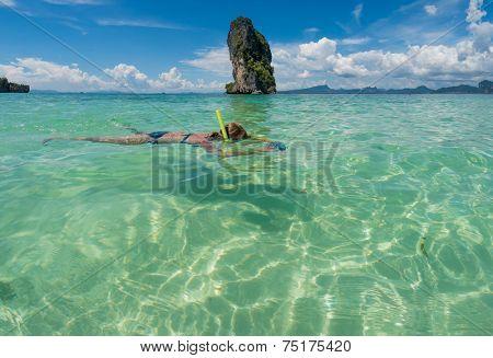 Beautiful woman snorkling in Krabi Thailand.