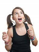 A beautiful teen girl in black top with pigtails. Portrait of smiling girl with two pigtails poster