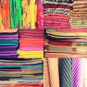 Set of textile material in a stack. Colorful cloth collection of images. Different colors of fabric,  great set poster