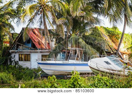 Destroyed House With Boats