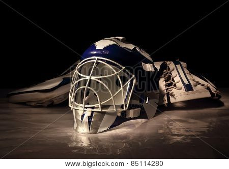 Studio photo of a hockey goalie mask and gloves against a dark background. poster
