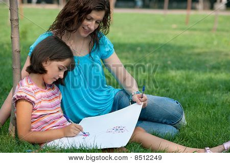 Portrait Of A Drawing Girl And Hir Mother