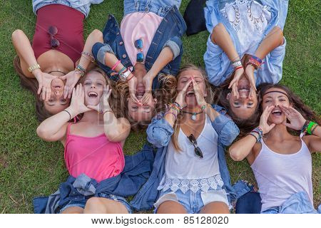 group of kids shouting or singing with cupped hands
