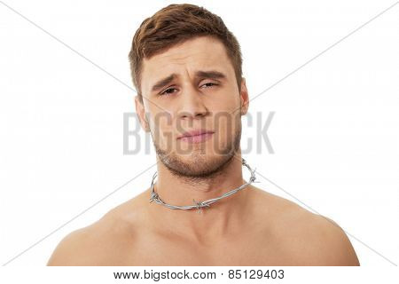 Handsome man with spikes around neck. Throat pain concept. poster
